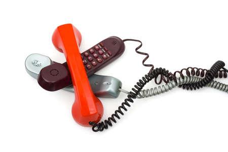 muddle: Heap of telephones, isolated on white background