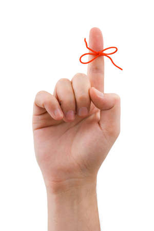 finger point: Red bow on finger, isolated on white background