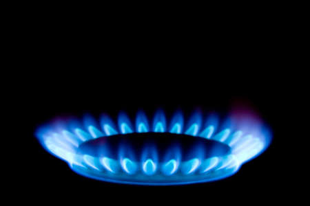 Flame of gas, isolated on black background photo