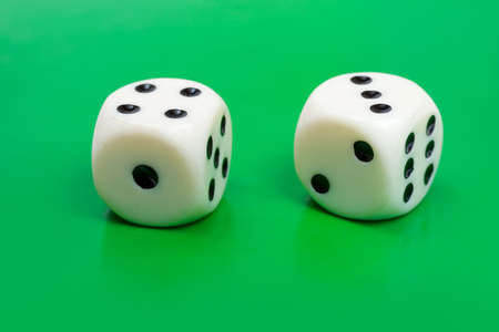 odds: Two gambling dices on green background Stock Photo