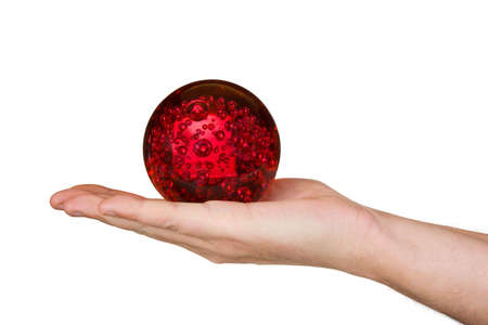 Magic sphere in hand, isolated on white background photo