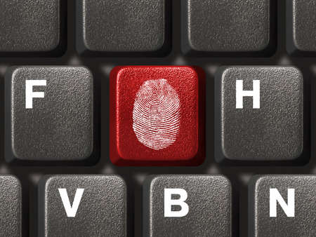fingerprinting: Computer keyboard with fingerprint, security concept