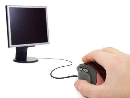 Hand with computer mouse and monitor, isolated on white background Stock Photo - 2732998