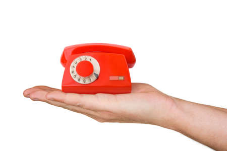 Hand and small telephone, isolated on white background photo