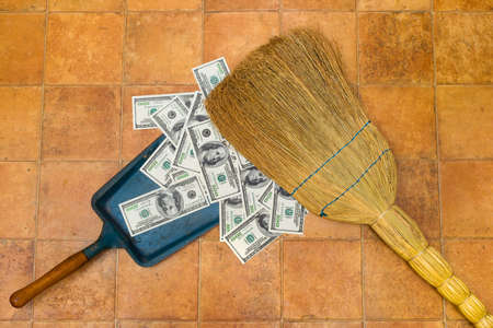 cleaning debt: Money and broom, business concept