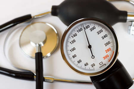 Scale of pressure and stethoscope, medical background photo
