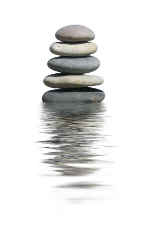 Stack of stones, isolated on white background photo