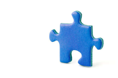 Slice of puzzle, isolated on white background photo