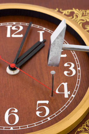 Clock, hammer and nail - time concept Stock Photo - 2825492
