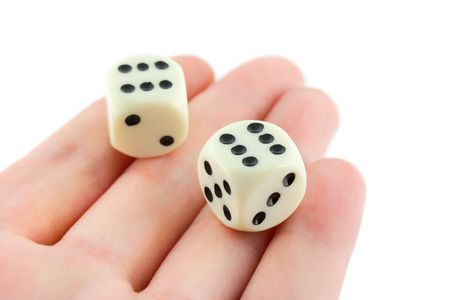 Two dices on hand, isolated on white background photo