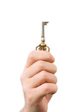 Hand giving retro key, isolated on white background photo