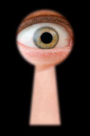 Eye in keyhole, isolated on black background Stock Photo - 2917085