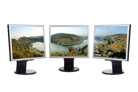 Panorama of bay (my photo) on computer screens, isolated on white background photo