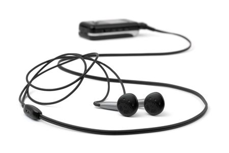 MP3 player and earphones isolated on white background photo