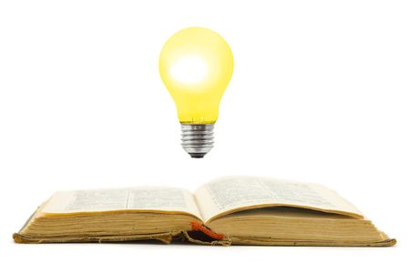 Retro book and lamp, isolated on white background photo
