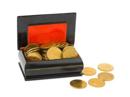 miserly: Gold money in chest, isolated on white background Stock Photo
