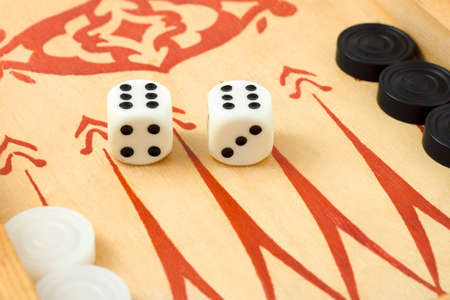 Macro of retro backgammon game and dices, isolated on white background photo