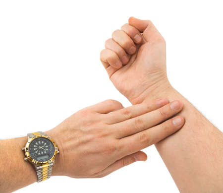 taking pulse: Hand taking pulse isolated on white background;