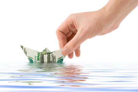 Hand launching money ship, isolated on white background Stock Photo - 3017743