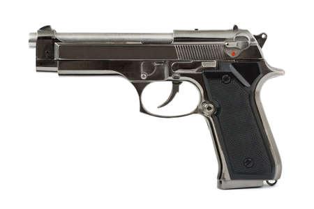 Closeup of pistol isolated on white background photo