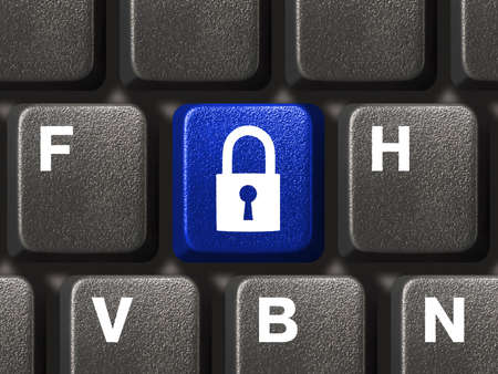 Computer keyboard with blue security key closeup Stock Photo - 3174205