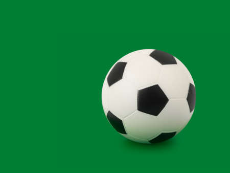 Soccer ball, isolated on green background Stock Photo - 3174214