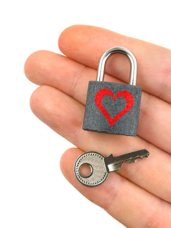Lock with heart and key in hand, isolated on white background photo
