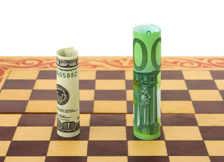 Money ( dollar and euro ) on chess board, isolated on white background photo