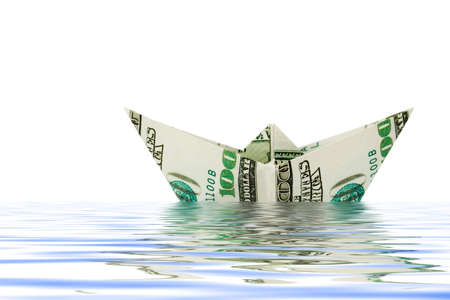Ship made of money in water, isolated on white background Stock Photo - 3275037