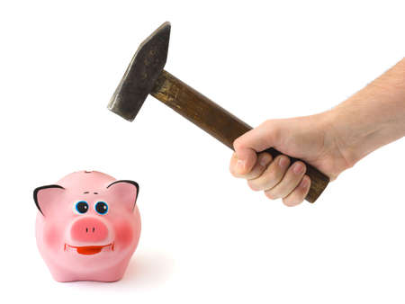 Hand with hammer and piggy bank, isolated on white background photo