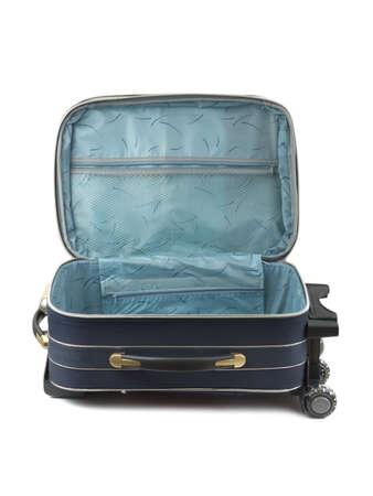 Opened travel case isolated on white background photo