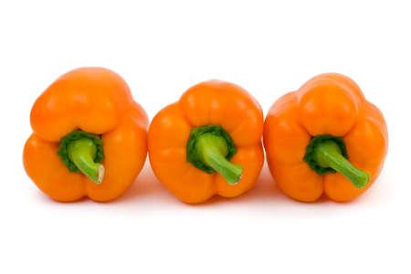 Three orange peppers isolated on white background photo