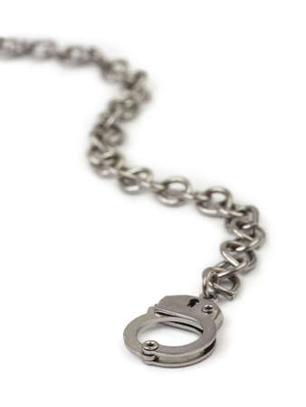 Chain and handcuffs isolated on white background photo