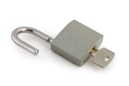 Opened lock and key isolated on white background Stock Photo - 3430903