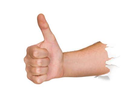 Hand punching thru paper isolated on white background photo