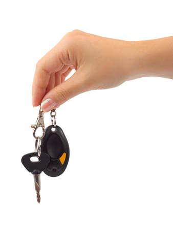 Hand and car key isolated on white background photo