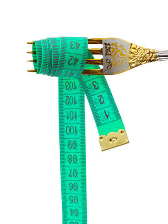 Fork and measuring tape isolated on white background photo