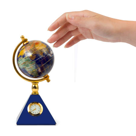 Hand and spinning globe isolated on white background photo