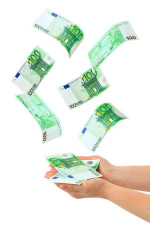 Hand and falling money isolated on white background photo