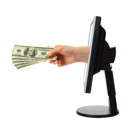 virtual office: Hand with money and computer monitor isolated on white background Stock Photo