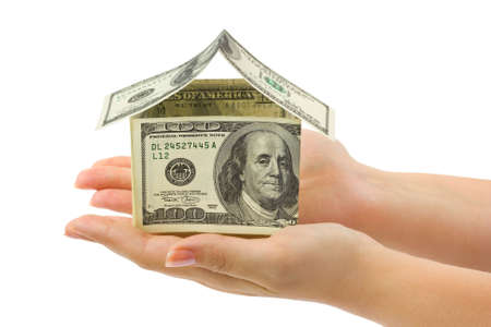 Money house in hands  isolated on white background photo