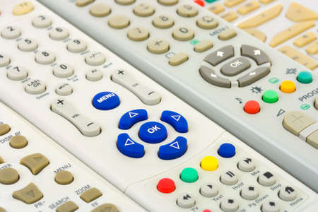 remote controls: Group of tv remote controls, abstract technology background Stock Photo