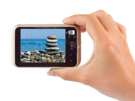 digicam: Photo camera in hand isolated on white background Stock Photo