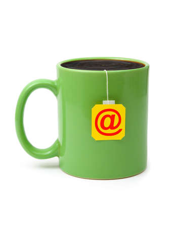 Cup of tea with e-mail symbol isolated on white background photo