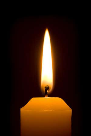 Macro of burning candle isolated on black background Stock Photo - 3671820