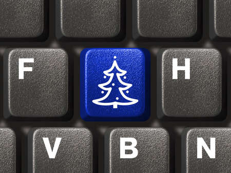 Computer keyboard with Christmas tree key, business concept