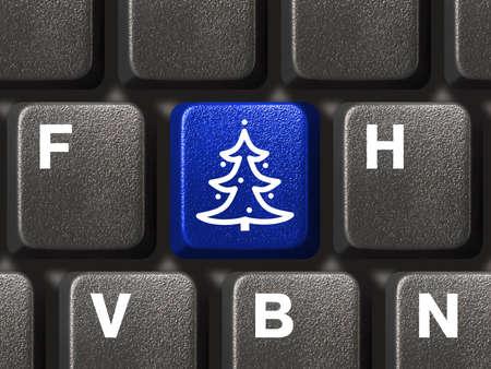 fiestas electronicas: Teclado de computadora con los principales �rboles de Navidad, una idea de negocio Foto de archivo