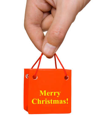 Hand with Christmas gift isolated on white background photo