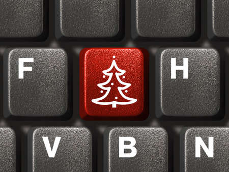 Computer keyboard with Christmas tree key, business concept photo