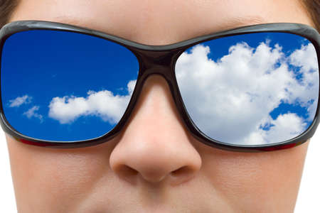 Woman in sunglasses and sky reflection isolated on white background
